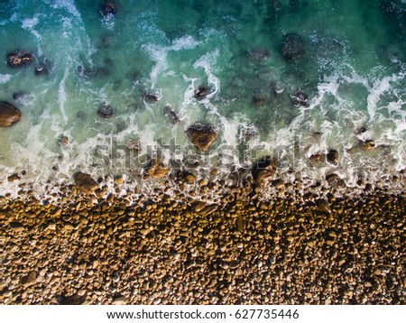 Beach rocks and shore from above #627735446