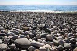 Beach round rocks texture