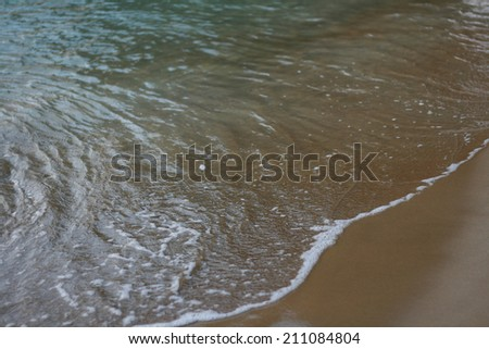 http://image.shutterstock.com/display_pic_with_logo/2064848/211080637/stock-photo-toy-tractor-on-the-sand-beach-summer-vacation-wheel-rake-bucket-plastic-fish-211080637.jpg