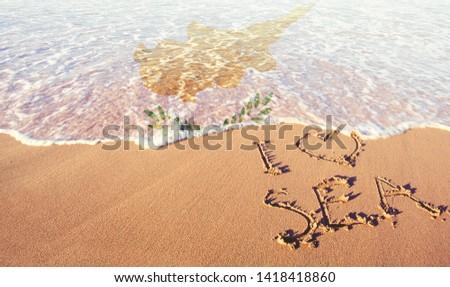 Beach sand, sea and flag Ciprus. I love Ciprus concept Stock fotó ©