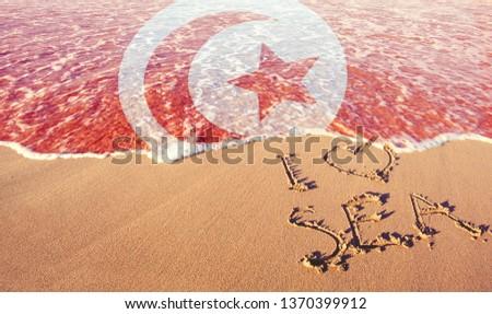Beach sand, sea and flag Tunisia,. I love Tunisia concept #1370399912