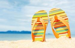 Beach sandals on the sandy coast