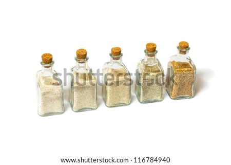 Beach sands varieties collection in five small glass bottles
