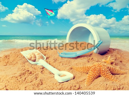beach scene with bucket and...