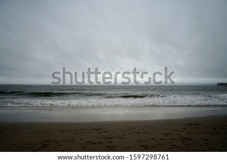 Beach Shoreline with Waves on a Cloudy Day
