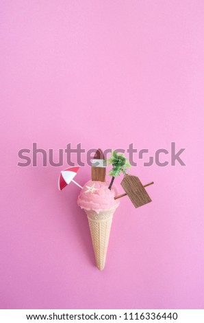 Beach sign, parasol, surfboard and pine tree inside a strawberry icecream cone with background space #1116336440