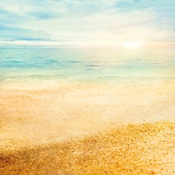 Beach summer background  with fine golden sand, sunset, sea and copyspace