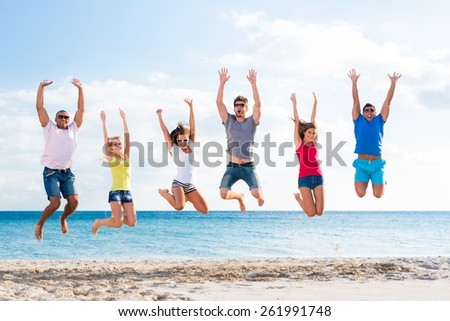 Beach. summer, holidays, vacation, happy people concept - group of friends jumping on the beach