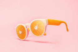 Beach sunglasses summer concept on pink background