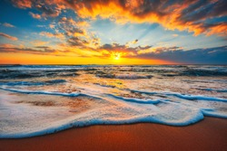 Beach sunrise  or sunset over the tropical sea and sky with clouds