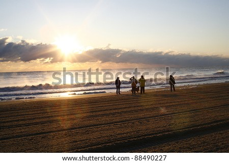 Beach Sunrise with family and dog walking down the beach