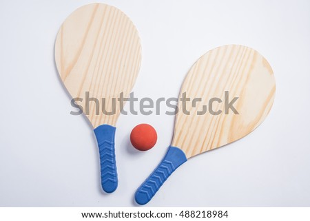 Beach tennis, beach paddle ball, matkot. Beach rackets and ball, overhead view.