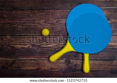 Beach Tennis Racket Set. Beach paddle tennis racket set with rubber ball, on a wooden background Сток-фото ©