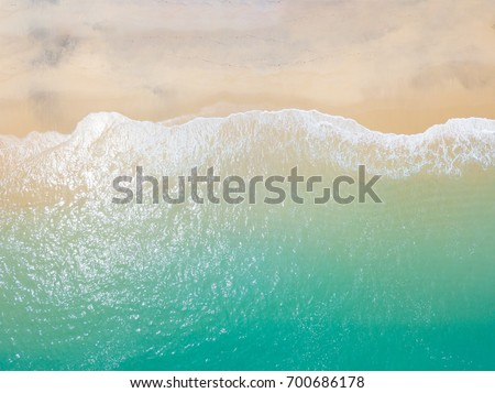 Beach top view with wave foam #700686178