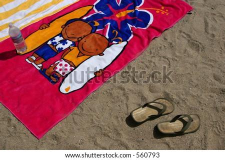 Beach towels and flip-flops at the beach in Ventura, California.