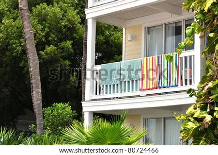 Beach Towels Hanging From Tropical Resort Balcony Railing