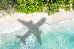 Beach travel traveling vacation sea symbolic picture airplane flying flight Seychelles water image