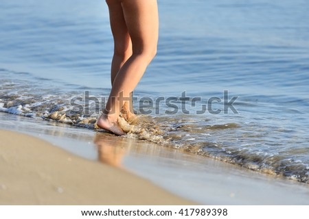 Beach travel woman walking on a sand beach #417989398