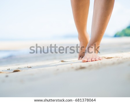 Beach travel - woman walking on sand beach. Closeup detail of female feet .Step up concept. #681378064
