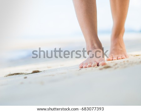 Beach travel - woman walking on sand beach. Closeup detail of female feet .Step up concept. #683077393