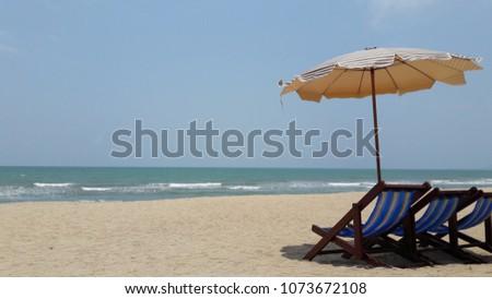 Beach umbrella Beach chair on the Beach. #1073672108
