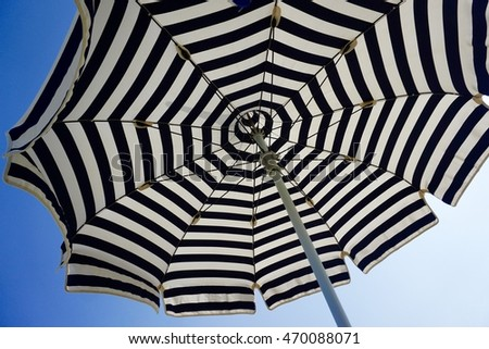 Beach Umbrella - Beach Umbrella with blue sky. Horizontal format.  #470088071