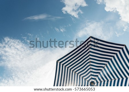 Beach umbrella on sunny day #573665053