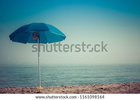 beach umbrella on the beach #1161098164