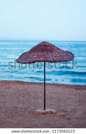 Beach umbrella on the beach #1173060523