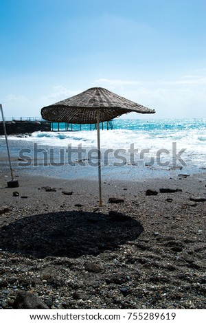 Beach umbrella on the beach  #755289619