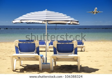Beach umbrella with deckchairs