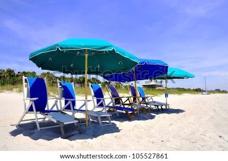 Beach Umbrellas and Beach Chairs waiting for sunbathers