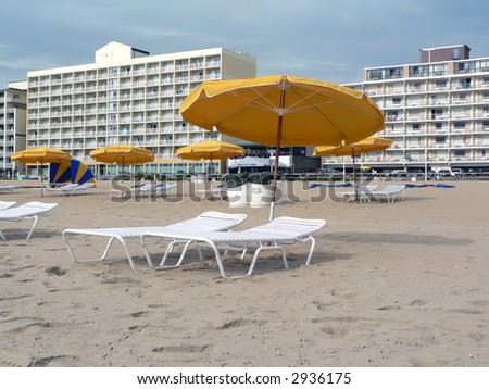 beach umbrellas and  lounge chairs at VA Beach before the crowds arrive