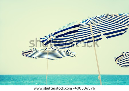 beach umbrellas  blue sea and...