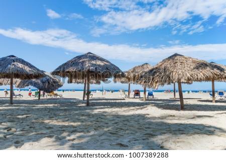 beach umbrellas on the beach #1007389288