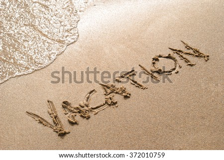 "Beach vacation; the word ""vacation"" written in sand #372010759"