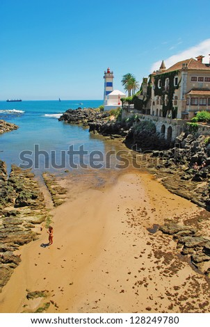beach view into lighthouse in Cascais, Portugal - stock photo