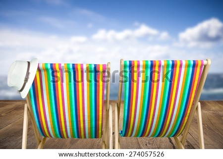 Beach. Vintage toned two beach chairs on tropical shore
