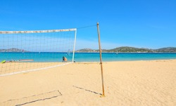 beach volley net and surfboards in Porto Pollo beach, Sardinia