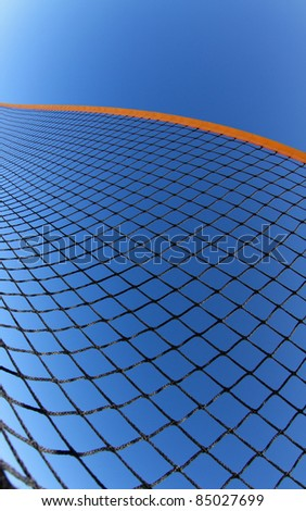 beach volleyball net in blue sky