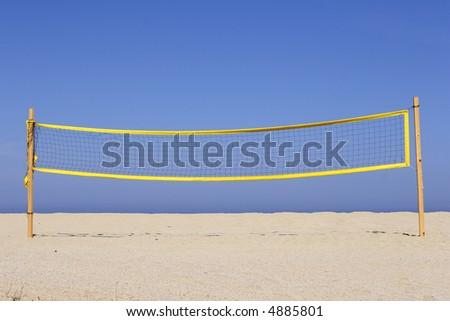 beach volleyball net on sandy beach, corsica, mediterranean - stock photo