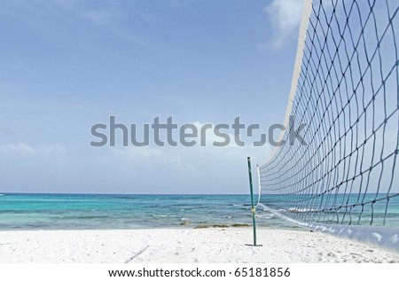 Beach volleyball, ocean, tropical, caribbean setting - stock photo
