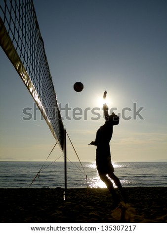 beach volleyball - silhouettes at sunset