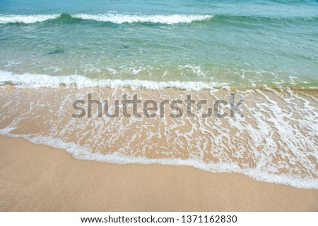 Beach waves of the sea on the sandy beach season Summer on top view background . #1371162830