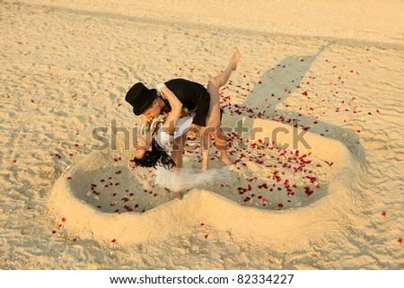 Beach wedding of happy newlywed couple