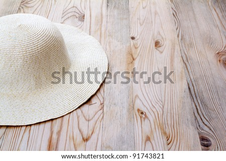 beach white hat on clear pine wood like Mediterranean style