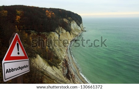 Beach with chalk cliff at island Ruegen  Mecklenburg-Vorpommern, Germany and warning sign