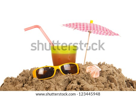 beach with drink glass and sunglasses and parasol - stock photo