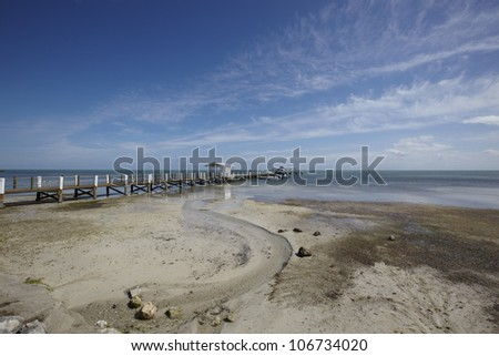 Beach with jetty in the background