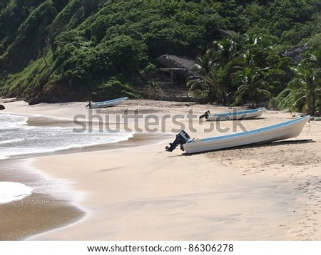 Beach with motorboat in Huatulco, mexico